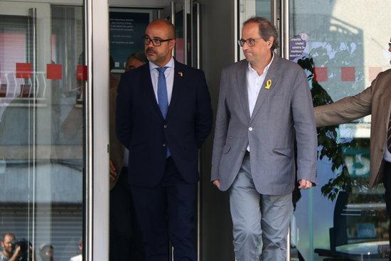 Miquel Buch, conseller d'Interior i Quim Torra, president de la Generalitat / ACN