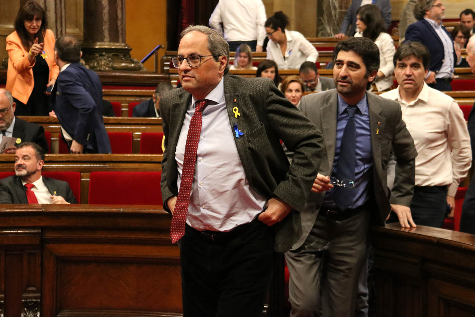 El president de la Generalitat, Quim Torra, sortint del ple del Parlament després de la votació de la moció que li demana eleccions