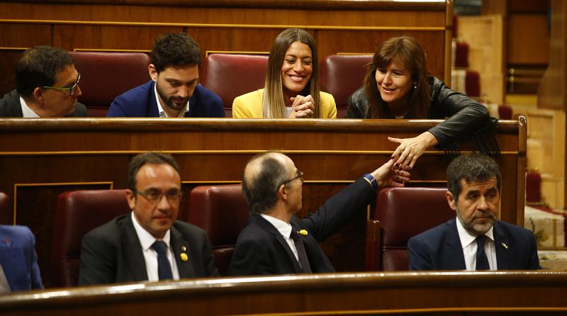 Els diputats de JxCat Jordi Sànchez, Jordi Turull i Josep Rull, asseguts als escons del Congrés dels Diputats durant la sessió constitutiva del 21 de maig del 2019