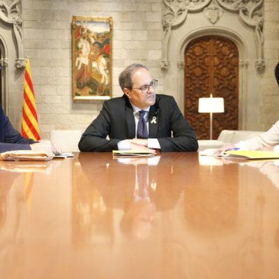 La presidenta de l'ANC, Elisenda Paluzie, i el vicepresident, Pep Cruanyes, reunits amb el president de la Generalitat, Quim Torra