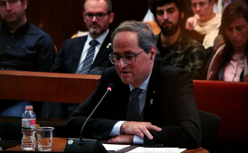 El president de la Generalitat, Quim Torra, responent a les preguntes del seu advocat durant el judici al TSJC per desobediència